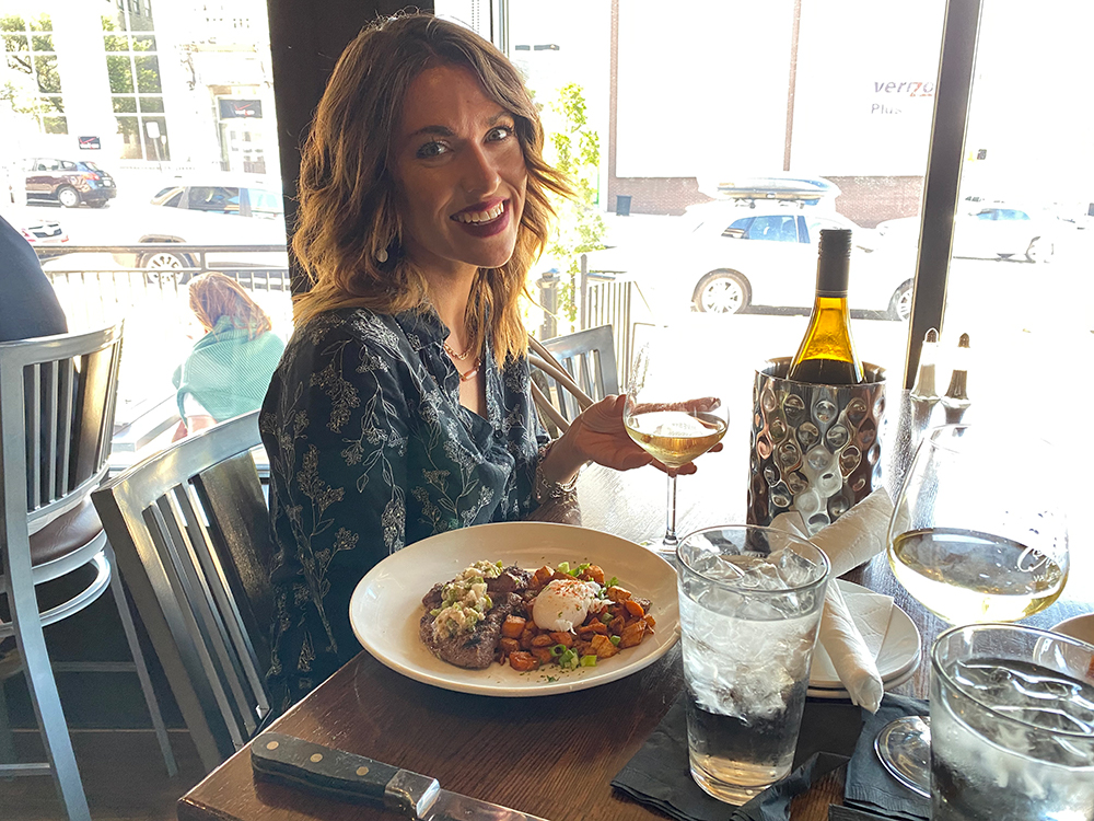 Woman enjoying wine at Cloud9
